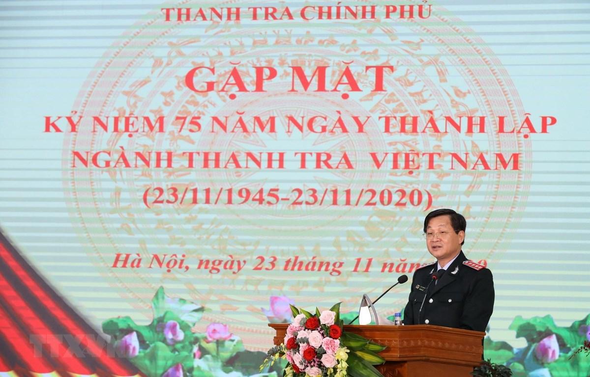 Ủy viên Trung ương Đảng, Tổng Thanh tra Chính phủ Lê Minh Khái ôn lại 75 năm xây dựng và trưởng thành ngành Thanh tra Việt Nam. (Ảnh: Văn Điệp/TTXVN)